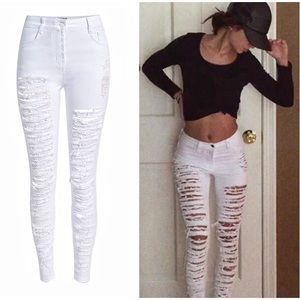 Jeans - ⭐️RESERVED⭐️ Distressed Torn white Jeans✨